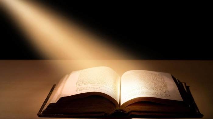 Image of light shinning on the Bible